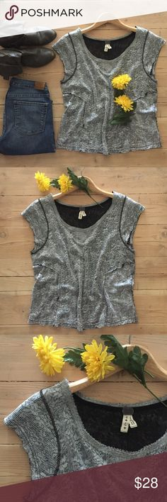 "| Free People Top Like new, Free People's ""We The Free"" shades of gray flower print, short sleeve top. Fits like a crop top but loose at the bottom for a flowy look.  79% cotton and 21"" polyester.  In excellent condition. Free People Tops"