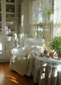 Cozy reading corner by a window ~ love the lace and houseplants