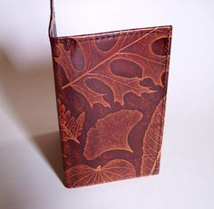 Beautiful leaf patterned leather checkbook cover.  <3
