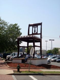 "Chair is a public artwork designed as an advertisement by Bassett Furniture, located in the Anacostia neighborhood of Washington, D.C.. It was once considered the world's largest chair. The chair was built in 1959 by Virginia-based furniture maker Bassett Furniture. The chair, which stands 19 1/2 feet high, is a detail-to-detail replica of a Duncan Phyfe style chair. Painted brown with a white & brown striped ""cushion"", the chair is entirely made of aluminum."