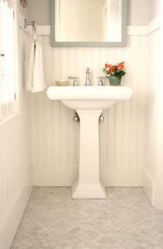 Monochromatic bathroom with beadboard makes a calm, lovely pair. #design #decor