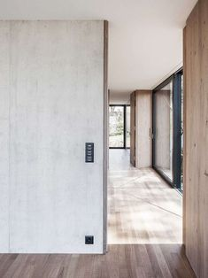 House in Riehen is a minimal home located in Basel, Switzerland, designed by Lukas Raeber Note Design Studio, Notes Design, Minimal Home, Switzerland, Tall Cabinet Storage, Minimalism, Garage Doors, Windows, Outdoor Decor