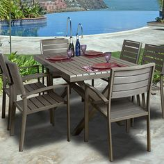7-piece indoor/outdoor dining set with slatted designs and aluminum frames.  Product: Table and 6 chairsConstruction ...
