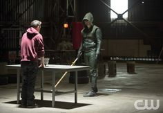 "Arrow -- ""Tremors"" -- Image AR212a_0007b -- Pictured (L-R): Colton Haynes as Roy Harper and Stephen Amell as The Arrow -- Photo: Cate Cameron/The CW -- © 2014 The CW Network, LLC. All Rights Reserved"