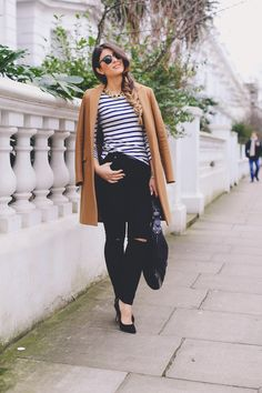 Distressed Black Jeans, stripped 3/4 sleeve top and brown trench jacket.