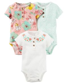 The perfect starters to any outfit, her classic bodysuits get a modern update with button plackets and feminine prints.