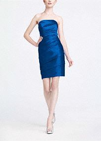 Simple yet stunning, this strapless satin style is a great go-to for your bridesmaids or any special occasion!  Flattering pleating all along the bodice and through the waist adds dimension while shaping a slimming silhouette.  Strapless neckline is sophisticated and elegant.  Rich satin fabric looks great in any light.  Fully lined. Back zip. Imported polyester. Dry clean only.   Available in our exclusive 40 color palette.  Get inspired by our colors.