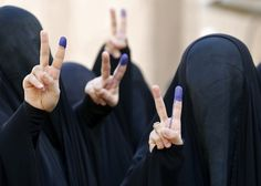 The 45 Most Powerful Photos Of 2014. Fully veiled Iraqi women flash the sign for victory with their ink-stained fingers after casting their vote at a polling station in Baghdad in Iraq's first parliamentary election since the withdrawal of U.S. troops.