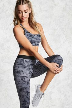 An athletic pair of stretch-knit leggings featuring a brushstroke-inspired stripe pattern, an elasticized waist, and a capri cut.