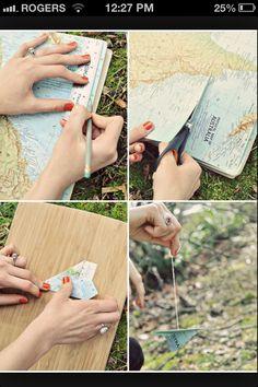 Idea: a dozen map paper planes as a center piece