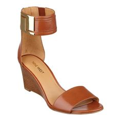 """Girly, girly! Day or night, these ankle strap wedge sandals shine with gleaming, glam details. Golden metallic hardware. Back zip closure for easy on/off. Padded footbed for all-day comfort. Snake-embossed leather upper. Man-made lining and sole. Imported. 2 3/4"""" mid wedge heels."""