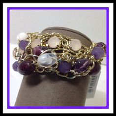 """Erica Lyons Shades of Purple Bracelet Stretchy bracelet with various shades of purple beads and gold chains. Looks like you are wearing several bracelets. Great for day or night. Approx. 2 1/4"""" diameter  PayPal  Trades  Holds Erica Lyons Jewelry Bracelets"""