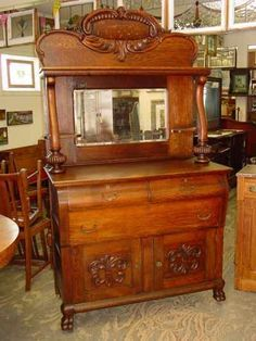 Antique Solid Quarter Sawn Tiger Oak Hall Mirror Back SideboardThis Antique Solid Quarter Sawn Tiger Oak Hall Mirror Back Sideboard, circa 1900, is quite a stunning piece. From top to bottom, with its...