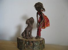 This sculpture depicts a little girl with her dog. It stands at 24cm tall, by 15cm wide. I endeavour to capture movement, dynamics, friendship and happiness in my sculptures; the tenderness between a mother and baby, or between two lovers; the dynamics of a dancing couple, the joy and energy of childhood. These are bespoke, quirky mixed media sculptures using wire, foil and fabric dipped into a weatherproof textile hardener called Paverpol. Each unique piece is individually made; as they…