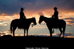 Cowboy and Cowgirl on Hilltop at Sunset, Wyoming