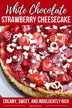 Easy White Chocolate Strawberry Cheesecake that is a white chocolate cheesecake that is topped with a strawberry filling and sweet white chocolate shavings. #chocolate #white #cheesecake #strawberry #recipe #dessert #sweet #rich #creamy