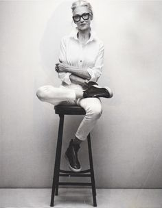 Eternal cool. Linda Rodin in a white button-front shirt, white denim jeans, high-top zippered sneakers.