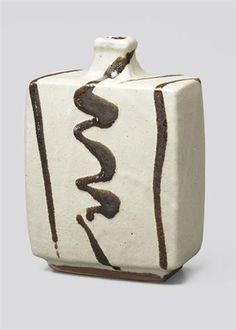 "SHOJI HAMADA  Flask bottle, c. 1965  Stoneware, dry, cream-coloured ""nuka"" glaze with shiny dark green poured loop design.  phillips.com"