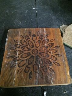 This unique piece has a flower burned into a piece of barn board. To order yours, go to designsbypk3.com or find Designs by Pk3 on Etsy!