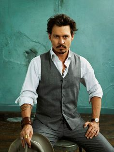 Johnny Depp.... torn up jeans or formal suit.... He looks good in it ALL!!!! <3 *swoons*