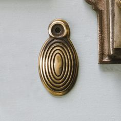 Our best selling oval beehive escutcheon made from brass with an aged finish. Superb quality and suits many styles of door knobs. Suitable for period and traditional homes and helps to neaten and reduce draughts from your keyhole. Antique Door Knobs, Antique Doors, Antique Brass, Knobs And Handles, Door Handles, Door Pulls, Traditional Front Doors, Keyhole Covers, Window Accessories