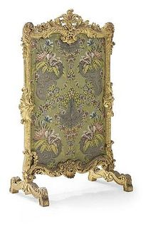 AN EARLY LOUIS XV CARVED GILTWOOD FIRESCREEN