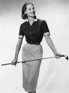 A woman modelling a tailored golfing skirt with a short-sleeved blouse and leather belt in the 50s. #golf #fashion