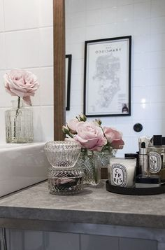 Blush roses, crystals &  Diptyque candles for bathroom décor.
