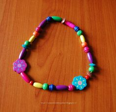 Tante piccole idee realizzate: Collana con perle di legno colorate fatta dalle mie bambine.