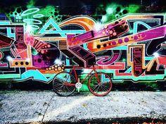 A Pure Fix Sierra against an art wall. #bike #bicycle #fixie #fixedgear #art #streetart #graffiti