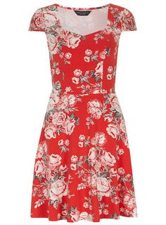 Short sleeve fit and flare dress with sweetheart neckline and all over print.