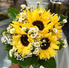 Sunflower Bridal Bouquet for a Summer Wedding. Gorgeous! Could be a DIY project if you (or maybe a bridesmaid?) has a green thumb!