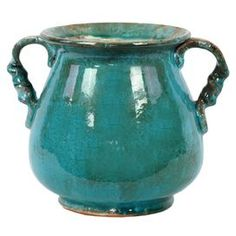 """Weathered vase with turned handles. Product: VaseConstruction Material: CeramicColor: TealDimensions: 8.5"""" H Cleaning and Care: Wipe with a damp cloth"""