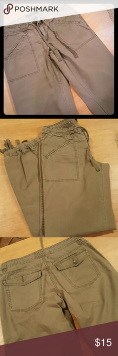Calvin Klein Olive Cargo Pants Olive colored. Very cute, comfy cotton pants. Gathered with ties at the ankle. Slit angled front pockets. Calvin Klein Pants Trousers