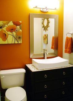 orange wall LOVE & cabinet sink LOVE