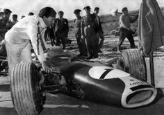 Jim Clark getting into his Lotus 49 at the Jarama Circuit, 1967. Found at www.8000vueltas.com