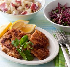 Wienerschnitzel- Thinly pounded breaded Veal. German potato salad and Red Cabbage. Need to make these things!