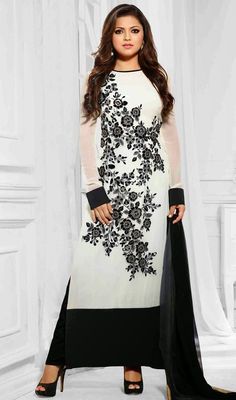 Look amazingly beautiful dressed in the style of Madhubala in this white embroidered chiffon and georgette salwar suit. The lovely lace and resham work throughout dress is awe-inspiring. #GorgeousLookBlackAndWhiteAnkleLengthSuit