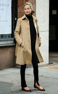 Parisian cool - black turtle neck and jeans with camel coat