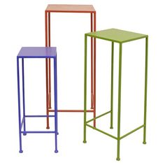 Display your favorite greenery or cherished family photos with these metal plant stands, showcasing slender silhouettes and vibrant finishes.