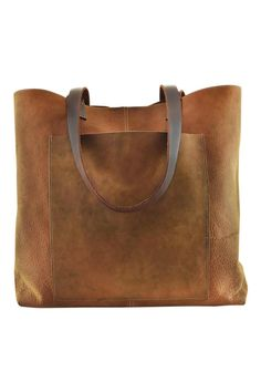 47b69d37bee1 Breathe and enjoy everyday adventures with the PCH Tote. The brown leather  has a soft
