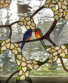 Lovebirds on dogwood? Marvelous use of glass as foreground and background