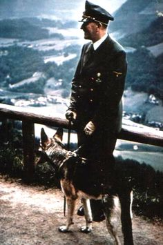 Five o'clock shadow on Hitler. Always a good thing. This is 1943 with Blondi, Obersalzberg.