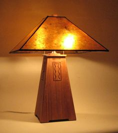 """The Sauslito Wood Lamp Available in 26"""" and 60""""  Shown in cherry with amber mica shade"""