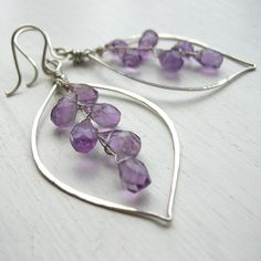 Glimmering handcut Amethyst briolettes are finely wrapped together and encircled by a hand formed and glently hammered leaf hoop. Amethyst is such a rare and beautiful colour in nature; found in its natural form here it really is a mouthwatering explosion of violet and purple. A