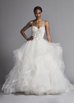a93d8f93d9e Spaghetti strap beaded bodice ball gown tulle tiered skirt wedding dress.