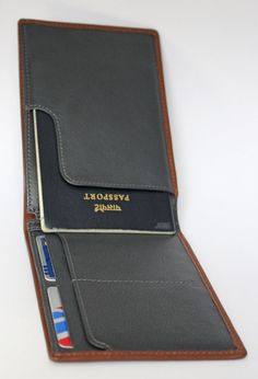 With two note sections, a tailored passport pouch and many card slots.   ★ Slim travel wallet  ★ Sections for passport, tickets, bills & cards ★ 4 quick