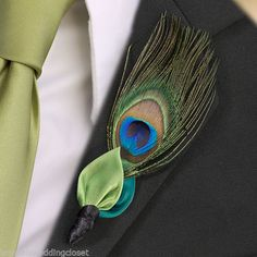 """Lovin' this non- traditional boutonniere. Nothing is sharper then the colors in a peacock feather. It's unique and budget friendly!"""