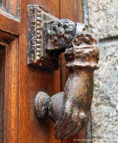 Ok, door knocker pinners....here's another unique and charming Antique door knocker on a home in France.