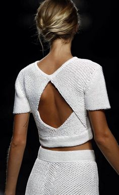 This white open-back crochet dress is a crisp look for the winter